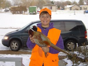 Josh with his 1st pheasant he shoot