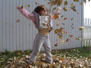 Cassie throwing leaves